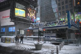 People head out from subway into snow in Times Square during a winter storm in New York City on Feb. 9, 2017. (Gordon Donovan/Yahoo News)