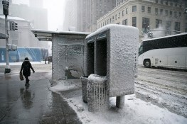 A news stand and phone booth are covered in slush along E. 42nd Street near Grand Central Terminal in New York on Feb. 9, 2017. (Gordon Donovan/Yahoo News)