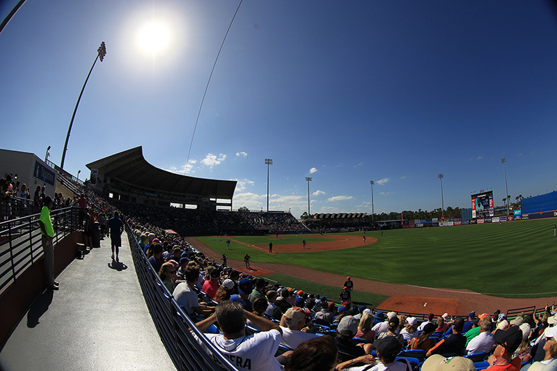 Fans watch the baseball game between the Detroit Tigers and New York Mets from the berm at First Data Field in Port St. Lucie, Fl., Sunday, Feb. 26, 2017. (Gordon Donovan/Yahoo Sports)
