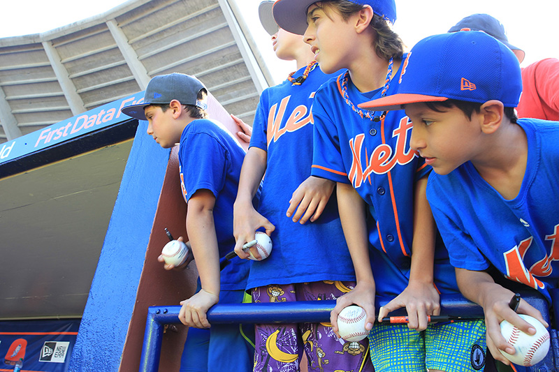 Young fans stand near the dugout fencing hoping for an autograph after the baseball game between the Houston Astros and New York Mets at First Data Field in Port St. Lucie, Fl., Monday, Feb. 27, 2017. (Gordon Donovan/Yahoo Sports)