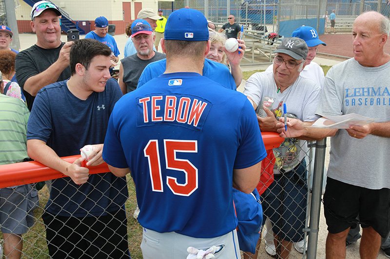 New York Mets prospect Tim Tebow signs for fans at the New York Mets spring training facility in Port St. Lucie, Fl., Tuesday, Feb. 28, 2017. (Gordon Donovan/Yahoo Sports)