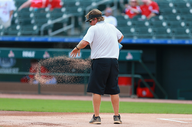 A grounds crew member prepares the field before the spring training baseball game against the New York Mets and St. Louis Cardinals at Roger Dean Stadium in Jupiter, Fl., Wednesday, March 1, 2017. (Gordon Donovan/Yahoo Sports)