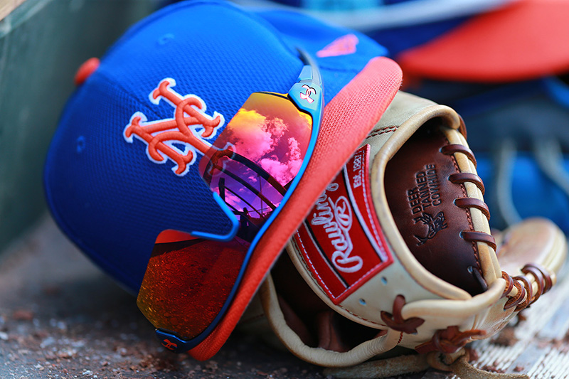 A reflection of the ballpark and sky appears on sunglasses on the dugout steps during a spring training baseball game between the New York Mets and St. Louis Cardinals at Roger Dean Stadium in Jupiter, Fl., Wednesday, March 1, 2017. (Gordon Donovan/Yahoo Sports)