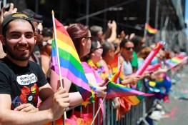 People cheer and wave rainbow flags during the N.Y.C. Pride Parade in New York on June 25, 2017. (Photo: Gordon Donovan/Yahoo News)
