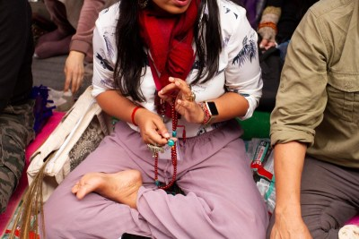 Woman with prayer beads