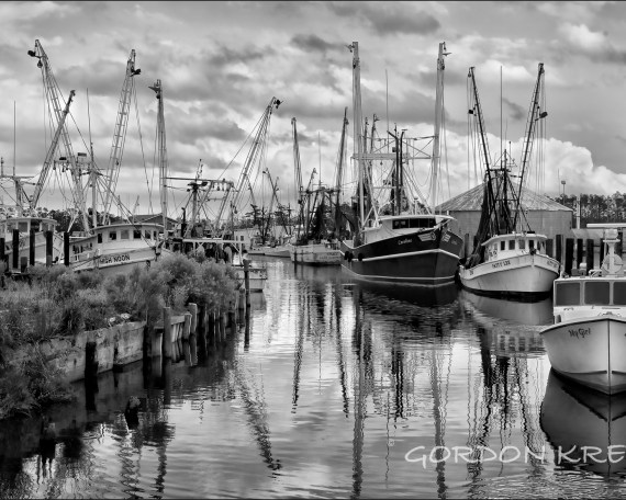 BLack and White photo of sailboats in a harbor