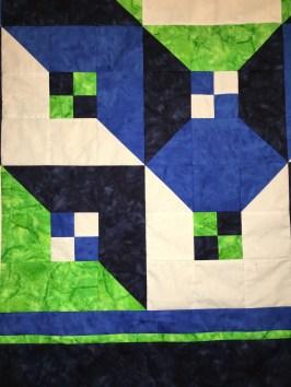 Desert Bloom Quilting Talavera Tile quilt pattern half square triangles HST 4-patch four patch Prisma Dyes Artisan Batik Batiks quilt fabric solids Seattle Seahawks