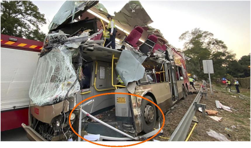 Bus in Hong Kong Tripped Over Low Barrier & Into Tree on Road Edge