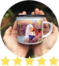 Woman's hands cup around a personalized enamel camping mug with dog artwork