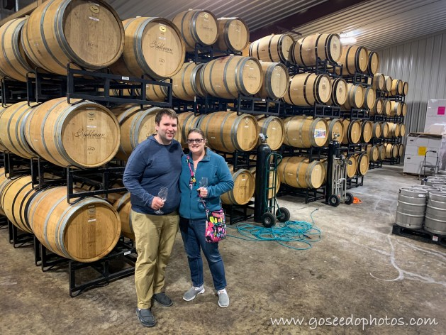 Portrait in front of Wine Barrels