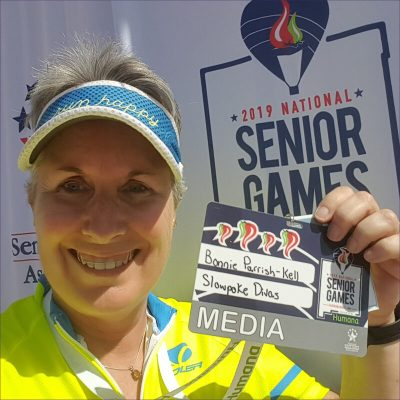 Bonnie Parrish-Kell holds her media pass to 2019 National Senior Games