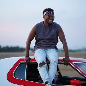 All things New by Travis Greene, Sitting on a red car
