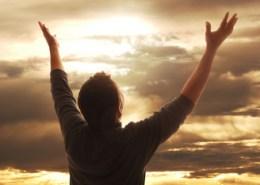 Man LIfint Hands in Praise
