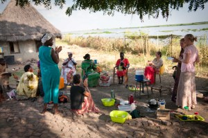 Ladies tea...we tried to pamper by making them coffee, Claudia brought Doughnuts and tons of nail polish! Here Nyadeng and I are sharing an attribute we've appreciated about each women and a prayer fro them as they return to their villages *photo courtesy of Tohru*