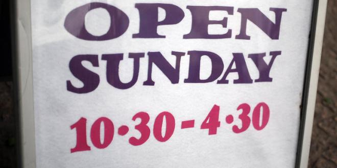 File photo dated 08/07/15 of a sign on the High street in Staines-upon-Thames, Surrey, telling customers of their Sunday opening times, as local authority chiefs are to be given the power to relax Sunday trading laws restricting the opening hours of large stores in their areas under new Government proposals. PRESS ASSOCIATION Photo. Issue date: Wednesday August 5, 2015. Councils in England and Wales will be given the choice of whether they want to ease the current rules limiting shops with over 280 sq m (3,000 sq ft) floorspace to six hours opening on a Sunday. See PA story CONSUMER Sunday. Photo credit should read: Steve Parsons/PA Wire