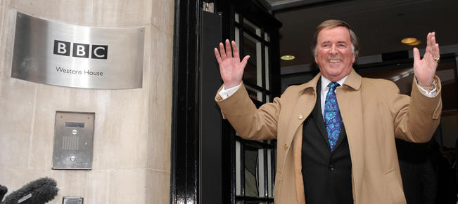 File photo dated 18/12/09 of Sir Terry Wogan leaving BBC Radio 2 in London after his final breakfast show, as the veteran broadcaster has died aged 77 following a short illness. PRESS ASSOCIATION Photo. Issue date: Sunday January 31, 2016. See PA story DEATH Wogan. Photo credit should read: Zak Hussein/PA Wire