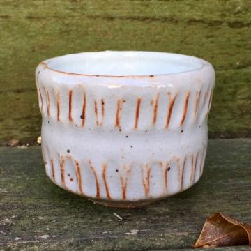 Chiseled tea bowl (Shaner white inside with shino outside) *n/a