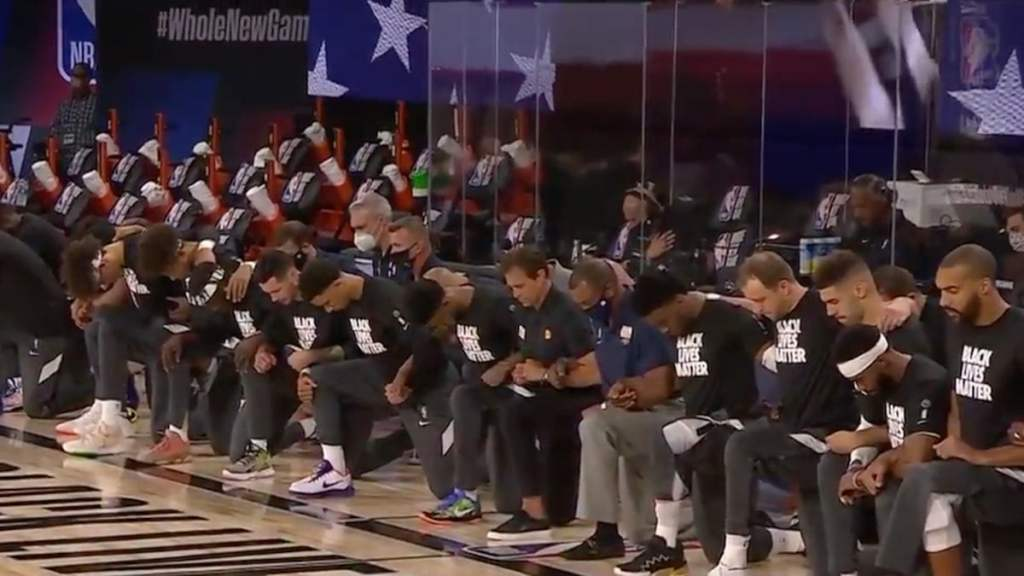 NBA Players, Coaches, Refs Kneel For National Anthem In 1st Game of Restart