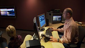 A video editor operating an AVID video softwar...