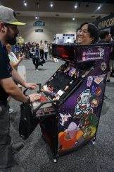 One of the most creative and coolest cosplays at the show, an actual working arcade cabinet. FYI, this con-goer is playing Dragon's Lair.