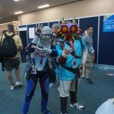 Sheik from The Legend of Zelda: Ocarina of TIme and Link from The Legend of Zelda: Breath of the Wild wearing the iconic Majora's Mask.