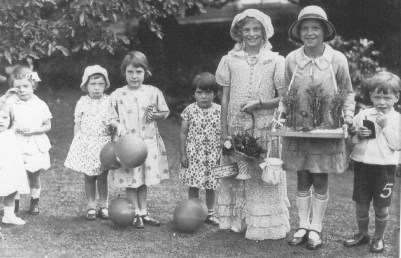 A church fete at Woolstone, 1930s.