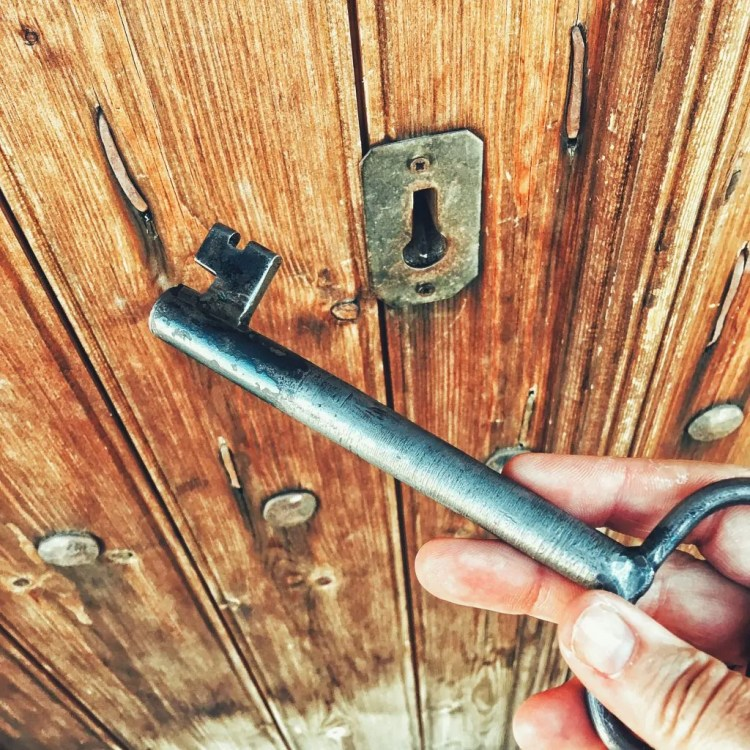 Holding the key to a 13th-century chapel