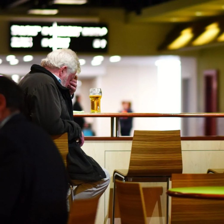 A man drinking a pint at 10 am in the Shannon Airport