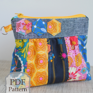 The Bella Clutch by Clover and Violet has a classic shape with a fun, colorful twist. Mix your favorite fabrics to create a one-of-a-kind look. -Sewtorial