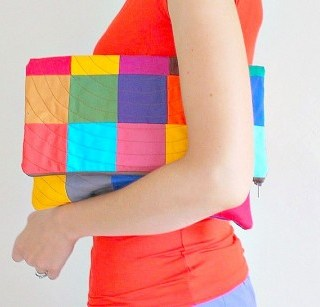 """In this patchwork clutch tutorial by Pippa Quilts, you'll learn how to take a fold over clutch and create """"drama"""" with patchwork and quilting. -Sewtorial"""