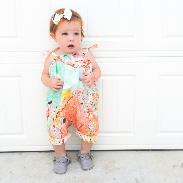 Learn how to upcycle a cloth tote into an adorable romper for your little one in this DIY Tote Bag Romper tutorial by One Little Minute.  -Sewtorial