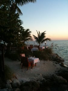 Dine with your feet in the sand at Little Palm Island.