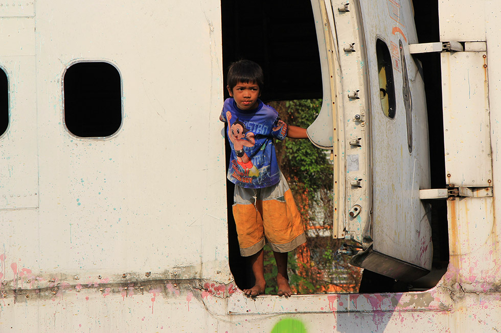 Cheeky Thai boy - Airplane Graveyard in Bangkok