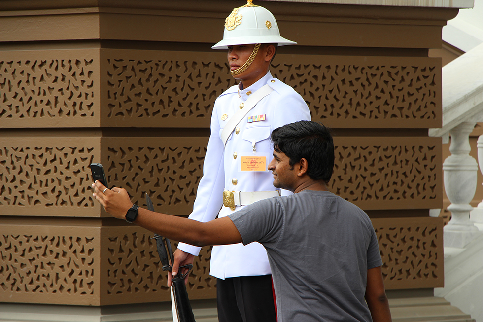Taking a selfie with one of the guards at Grand Palace in Bangkok