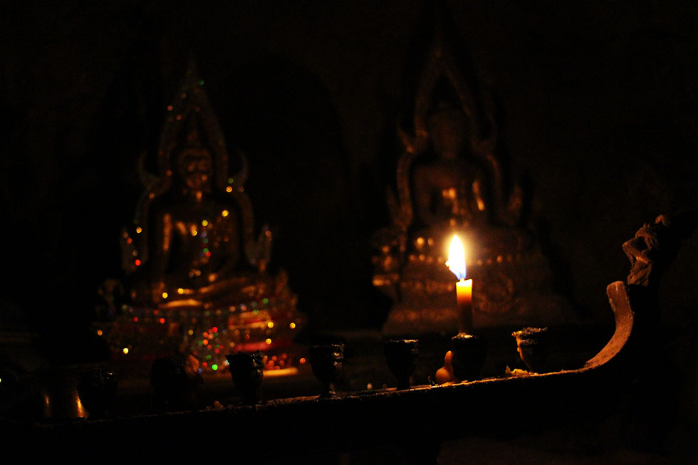 Lighting a candle - Phraya Nakhon Cave