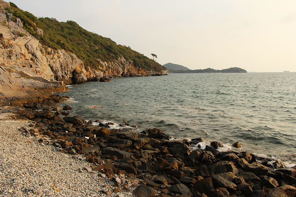Enjoying the sunset from the rocky shore of Koh Si Chang