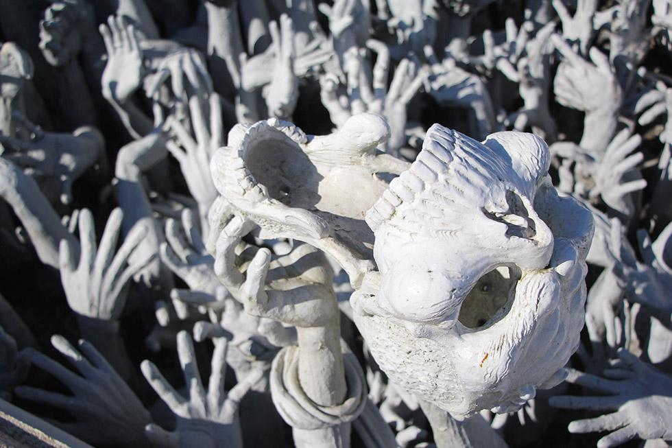 Hands and skulls at Wat Rong Khun