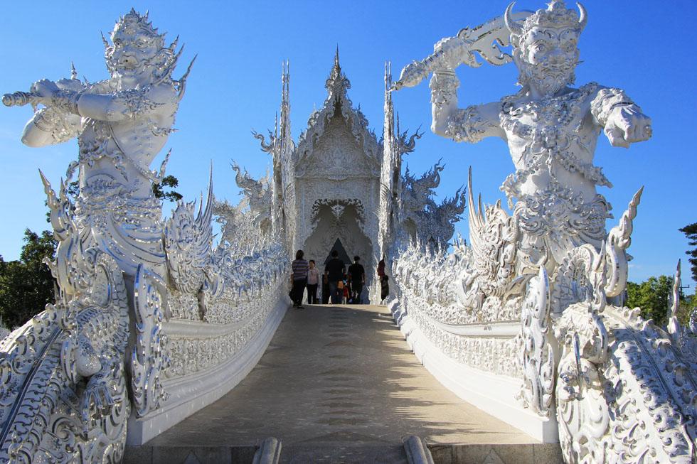 Gatekeepers at Wat Rong Khun in Chiang Rai