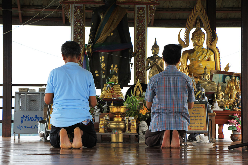 Praying locals at Wat Chalermprakiat in Lampang
