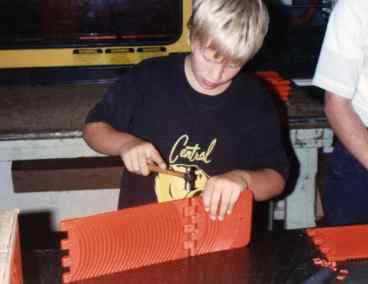 Our son, James, assembling a Go Treads tool July 5, 1991.