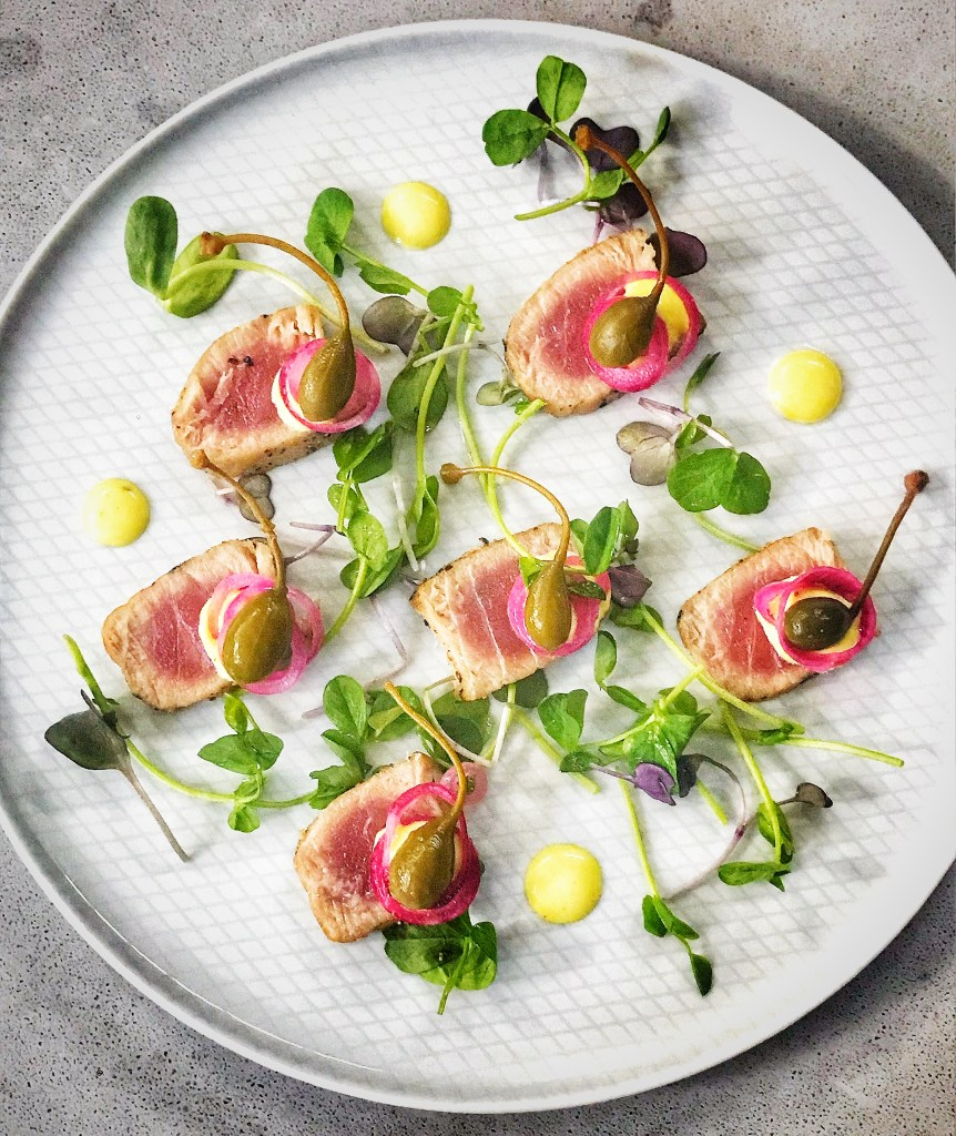 Seared tuna starter - appetizer with tuna, honey mustard mayo, pickled red onions and capers
