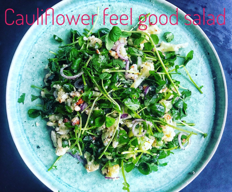 Cauliflower feel good salad with microgreens, almonds, red onion, fresh herbs