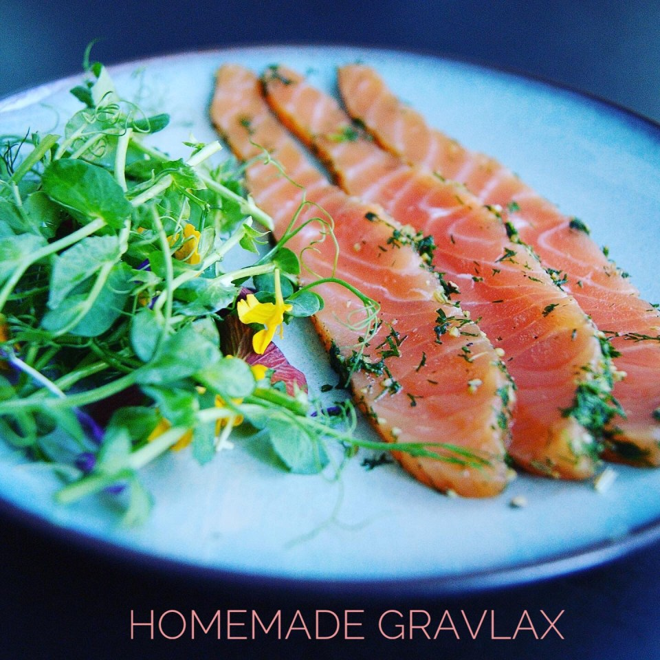 Homemade gravlax with greens