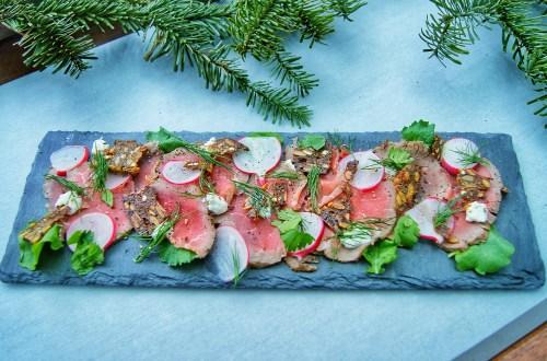 Nordic carpaccio with horseradish cream, radish, rye bread croutons and fresh herbs
