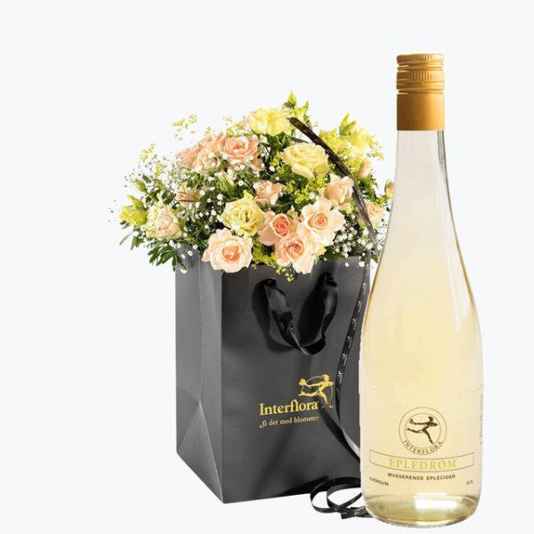 Cider gavepose med blomsterbukett.