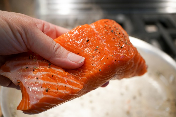 add salmon to the pan