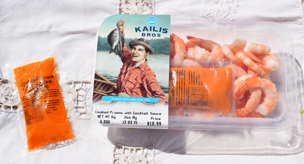 Kailis Bros Cooked Prawns with a sachet of Seafood Cocktail Sauce.
