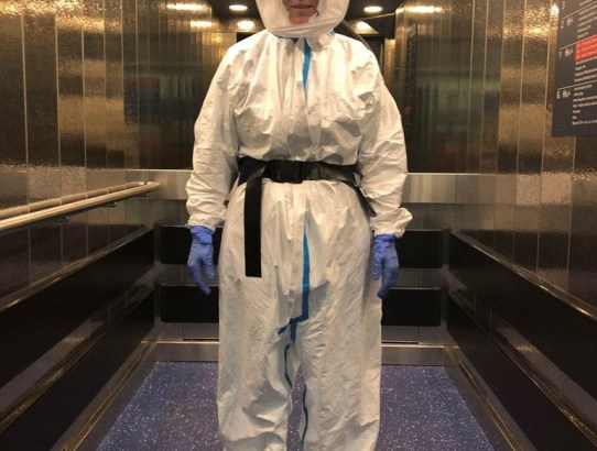 Spacesuit-Site-Practitioner-Clare-with-hood-going-to-pick-up-a-Covid-Patient