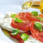 Olive oil on Caprese salad