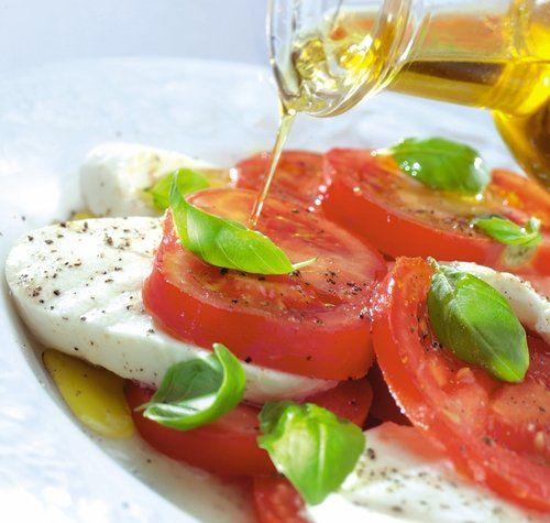 Extra Virgin Olive Oil on Caprese salad